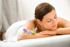 Woman in Spa. An attractive caucasian woman lying down in a spa royalty free stock photography
