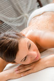 Woman in Spa. An attractive caucasian woman getting a scrub in a spa stock images