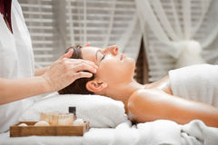 Woman in Spa. An attractive caucasian woman getting massaged in a spa Royalty Free Stock Photography