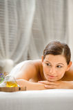 Woman in Spa. An attractive caucasian woman lying down in a spa stock photos