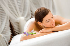 Woman in Spa. An attractive caucasian woman lying down in a spa stock photography