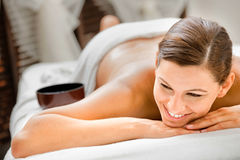 Woman in Spa. An attractive caucasian woman lying down in a spa stock image