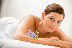 Woman in Spa. An attractive caucasian woman lying down in a spa royalty free stock photos