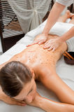 Woman in Spa. An attractive caucasian woman getting a scrub in a spa Royalty Free Stock Images