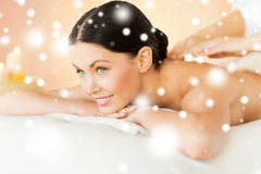 Woman in spa. Health and beauty concept - woman in spa salon getting massage royalty free stock images