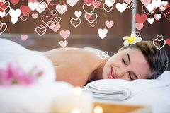 Woman in spa against digitally generated background. With hearts Stock Photography
