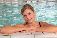 Woman in spa bath. Closeup of beautiful woman in spa center royalty free stock photos