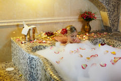 Woman in spa bath Stock Images
