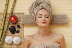 Woman in SPA. Beautiful young woman relaxing in spa salon Stock Photo