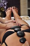 Woman at spa with black stones Royalty Free Stock Photo