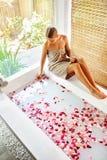 Woman Spa Body Care Treatment. Flower Rose Bath. Beauty, Skincare Royalty Free Stock Photos