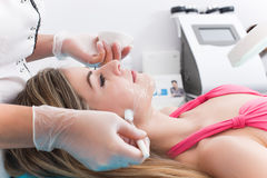 Woman in spa clinic. Woman doing cosmetic procedures in spa clinic Stock Image