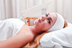 Woman in spa clinic Stock Photography