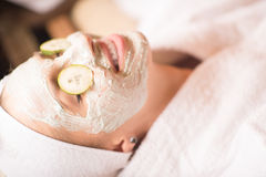 Woman in spa  with cosmetic mask Royalty Free Stock Image
