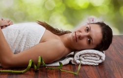 Woman in spa environment Stock Photography