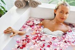 Woman Spa Flower Bath. Aromatherapy. Relaxing Rose Bathtub. Beauty Stock Photos