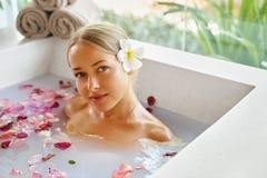 Woman Spa Flower Bath. Aromatherapy. Relaxing Rose Bathtub. Royalty Free Stock Image
