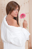 Woman in spa with flower and bathrove Stock Photos
