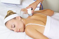 Woman in spa getting electric Stock Photo