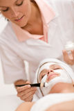 Woman at spa getting facial mask Stock Photo