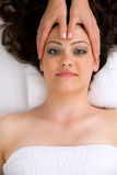 Woman in a spa getting a head massage. Royalty Free Stock Photos