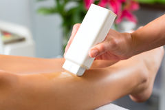 Woman in Spa getting leg waxed. Young woman in Spa getting legs waxed for hair removal Stock Photography
