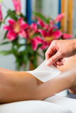Woman in Spa getting leg waxed. Young woman in Spa getting legs waxed for hair removal Stock Photo