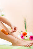 Woman in Spa getting leg waxed for hair removal. Young woman in Spa getting legs waxed for hair removal Royalty Free Stock Photography