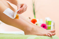 Woman in Spa getting leg waxed. Young woman in Spa getting legs waxed for hair removal Royalty Free Stock Photo