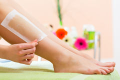 Woman in Spa getting leg waxed. Young woman in Spa getting legs waxed for hair removal Royalty Free Stock Photos