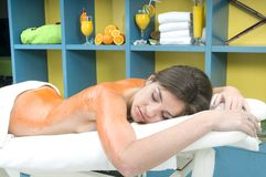 Woman in a spa getting massage Stock Images