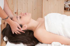 Woman in spa getting a massage on her face Royalty Free Stock Images