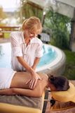 Woman at the spa getting a massage royalty free stock photography