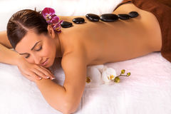 Woman in spa  having body relaxing massage. Woman in spa salon having body relaxing massage Stock Image