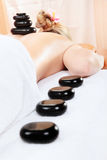 Woman in spa having massage. Woman in spa having hot stones massage Royalty Free Stock Photo