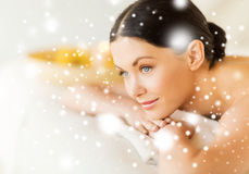 Woman in spa. Health and beauty concept - woman in spa salon lying on the massage desk Royalty Free Stock Photography