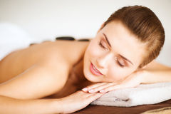 Woman in spa with hot stones Royalty Free Stock Photography