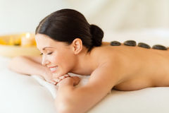 Woman in spa with hot stones Royalty Free Stock Images