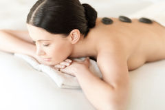 Woman in spa with hot stones Royalty Free Stock Image