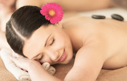 Woman in spa with hot stones Stock Photography