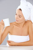 Woman at a spa looking at a mug of coffee Stock Photo