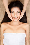Woman at a spa, lying on her back, smiling, ge Royalty Free Stock Images