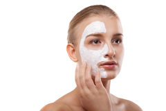 Woman with spa mask on her face isolated Royalty Free Stock Photo