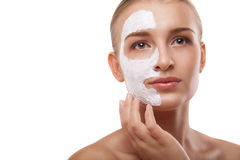 Woman with spa mask on her face isolated Stock Photos
