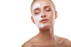 Woman with spa mask on her face isolated Royalty Free Stock Photography