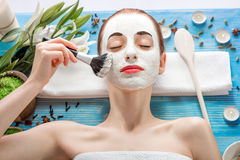 Woman with spa mask Stock Photos