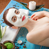 Woman with spa mask Royalty Free Stock Image