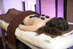Woman on spa massage with stones Royalty Free Stock Photo
