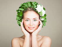 Woman Spa Model with Clear Skin, Green Eyes and Wreath o Royalty Free Stock Image