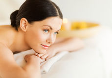 Woman in spa. Picture of woman in spa salon lying on the massage desk Royalty Free Stock Photos